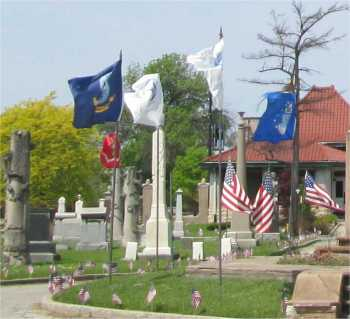 Small American flags and larger service flags flanked the large American flag for Memorial Day.